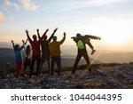 joyful hikers  friends with... | Shutterstock . vector #1044044395