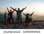 happy hikers  friends with open ... | Shutterstock . vector #1044044401