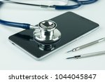 stethoscope on the smartphone... | Shutterstock . vector #1044045847