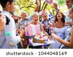 family celebration or a garden... | Shutterstock . vector #1044048169
