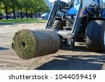 rolled sod or turf is machine... | Shutterstock . vector #1044059419