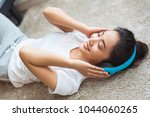 asian women are listening to... | Shutterstock . vector #1044060265