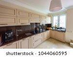 modern kitchen interior.... | Shutterstock . vector #1044060595