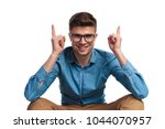 smiling young seated man... | Shutterstock . vector #1044070957