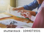 business people discussing the... | Shutterstock . vector #1044073531