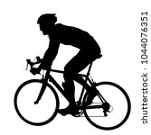 silhouette of a cyclist male on ... | Shutterstock .eps vector #1044076351