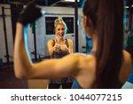 two girls in fitness center.... | Shutterstock . vector #1044077215