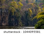 river view with raft house on... | Shutterstock . vector #1044095581