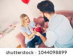 modern young man surprising his ... | Shutterstock . vector #1044098899