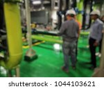 blurred of engineers analyzing... | Shutterstock . vector #1044103621