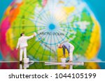 miniature people   painters... | Shutterstock . vector #1044105199