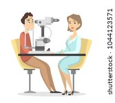 checking the eyesight with... | Shutterstock .eps vector #1044123571