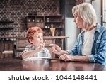 time to study. nice smart aged... | Shutterstock . vector #1044148441