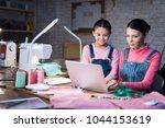 a little girl and an adult... | Shutterstock . vector #1044153619
