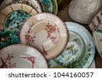antique ceramic dishes resting...   Shutterstock . vector #1044160057