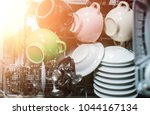 open dishwasher with clean... | Shutterstock . vector #1044167134