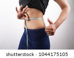 weight loss success with hand... | Shutterstock . vector #1044175105