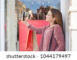 beautiful young consumer woman... | Shutterstock . vector #1044179497