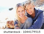 tourist mother and teenager son ... | Shutterstock . vector #1044179515
