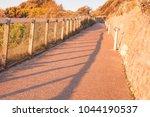 a footpath in the sun light   Shutterstock . vector #1044190537