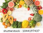 frame of fruits and vegetables... | Shutterstock . vector #1044197437