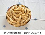 Small photo of Top view of a Plate of Kaab El Ghazal, a moroccan sweet also known as gazzele horns due to his peculiar shape made mainly with almonds and wheat flour. Shot on a traditional handmade tablecloth