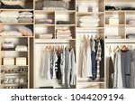 large wardrobe closet with... | Shutterstock . vector #1044209194