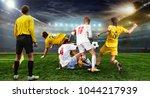 stadium in the evening in full... | Shutterstock . vector #1044217939