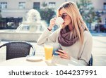 beautiful woman sitting in a...   Shutterstock . vector #1044237991