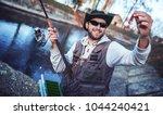 fisherman enjoys in fishing on...   Shutterstock . vector #1044240421