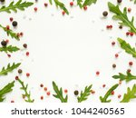frame of green arugula leaves... | Shutterstock . vector #1044240565