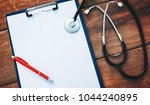 doctor desk. stethoscope with...   Shutterstock . vector #1044240895