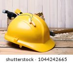 hard hat and earplugs on table. ... | Shutterstock . vector #1044242665