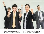 happy business people cheering... | Shutterstock . vector #1044243385
