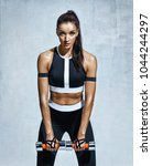 sporty woman does the exercises ... | Shutterstock . vector #1044244297