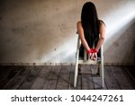 victim woman tied with red rope ... | Shutterstock . vector #1044247261