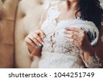 great feather in the hands of... | Shutterstock . vector #1044251749