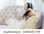 young bride in a lace dress... | Shutterstock . vector #1044251755