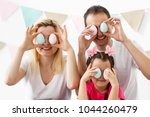happy family with easter eggs....   Shutterstock . vector #1044260479