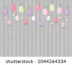 colorful hanging easter eggs....   Shutterstock .eps vector #1044264334
