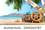 summer desk and suitcase  | Shutterstock . vector #1044264787