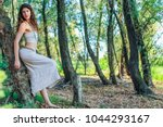 pagan woman resting against the ... | Shutterstock . vector #1044293167