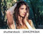 beautiful pagan woman looking... | Shutterstock . vector #1044294364