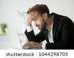 worried stressed businessman in ... | Shutterstock . vector #1044298705