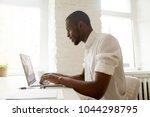 african businessman working on... | Shutterstock . vector #1044298795