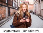 young beautiful blonde and... | Shutterstock . vector #1044304291