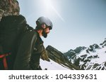 Small photo of Man adventurer climbing on mountain top Travel adventure lifestyle concept outdoor active extreme vacations