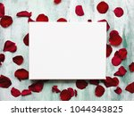 Stock photo mockup poster on wooden board with flowers petals white canvas on stretcher romantic background 1044343825