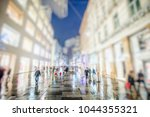 crowd of people walking on city ... | Shutterstock . vector #1044355321