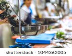 fish market workers | Shutterstock . vector #1044362005